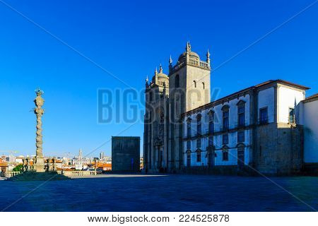 PORTO, PORTUGAL - DECEMBER 24, 2017: View of the Cathedral (Se), with locals and visitors, in Porto, Portugal