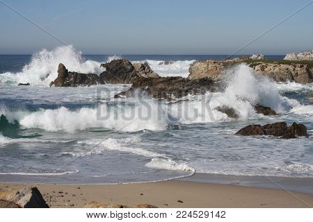 This is a winter image of waives and rocks along the coast of Pacific Grove Calif. USA.
