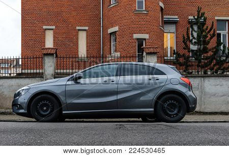 STRASBOURG, FRANCE- JAN 31, 2018: Side view of luxury silver Mercedes-Benz car parked on a French street