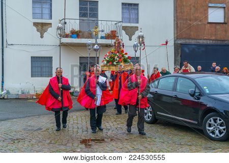 DUAS IGREJAS, PORTUGAL - DECEMBER 26, 2017: Villagers take part and circle the church, in the celebration of Santo Estevao, as part of Christmas event, in Duas Igrejas, Portugal