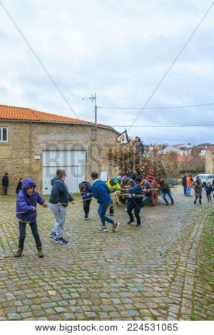 DUAS IGREJAS, PORTUGAL - DECEMBER 26, 2017: Villagers take part and carry woods, in the celebration of Santo Estevao, as part of Christmas event, in Duas Igrejas, Portugal