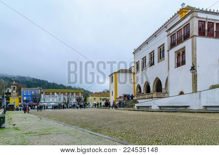SINTRA, PORTUGAL - DECEMBER 28, 2017: View of the National Palace, with visitors, in Sintra, Portugal