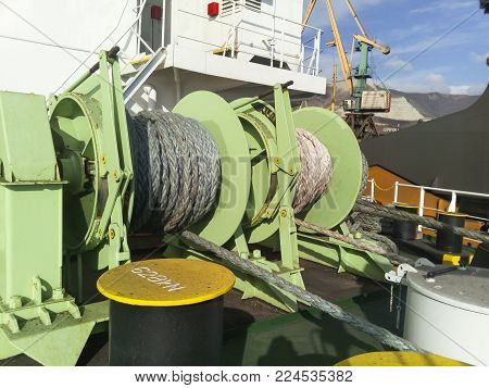 Babina with a sea mooring rope. Mooring on the ship.