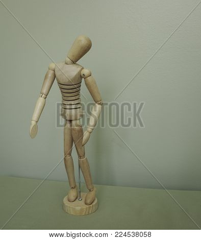 Artist's mannequin posed in standing position with head tilted