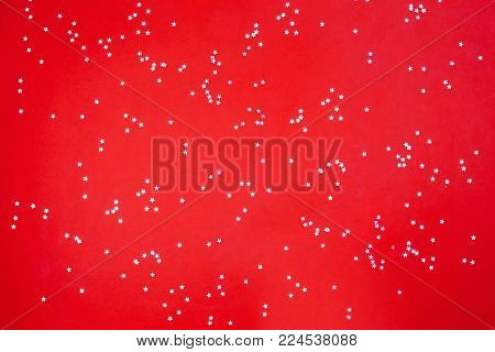 Gold metallic stars on a red background