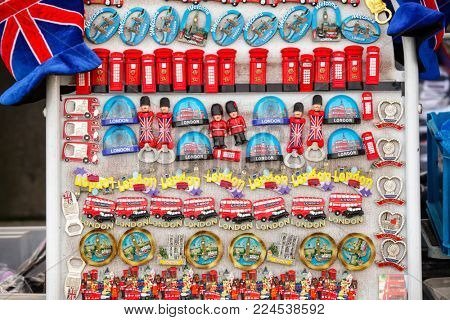 LONDON, UK - OCTOBER 28, 2012: Street stall with typical London tourist fridge magnet souvenirs for sale