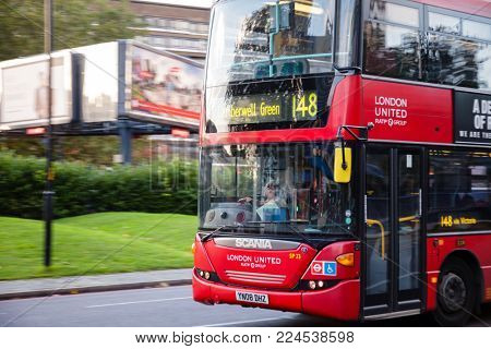 LONDON, UK - OCTOBER 27, 2012: Double Decker bus moves along street in Southwark Greater London