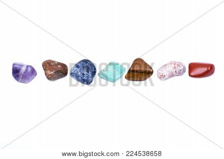 Set Of Seven Healing Chakra Stones For Crystal Healing, Isolated On White Background