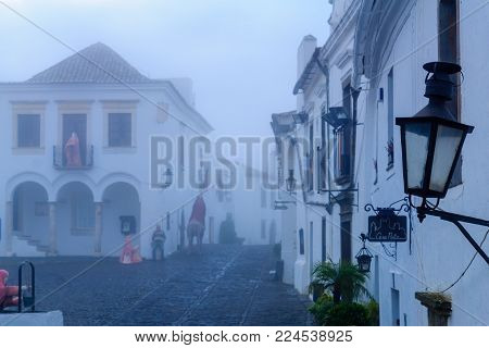 MONSARAZ, PORTUGAL - DECEMBER 30, 2017: View of Direita street (the main street) in the historic village, with local businesses, in Monsaraz, Portugal