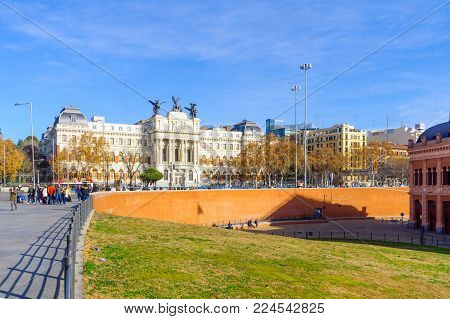 MADRID, SPAIN - JANUARY 1, 2018: View of the Agriculture ministry building, with locals and visitors, in Madrid, Spain