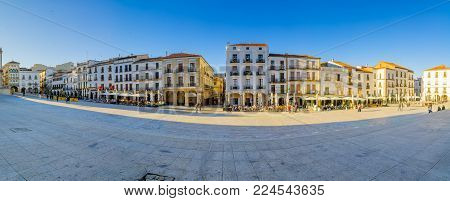 CACERES, SPAIN - DECEMBER 21, 2017: Panoramic view of the Plaza Mayor (main square), with local businesses, locals and visitors, in Caceres, Extremadura, Spain