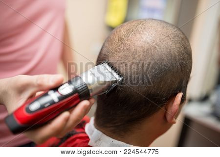 Men's grooming trimmer in a beauty salon .