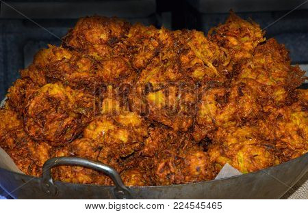 Onion Bhajis in a wok for sale on a market stall