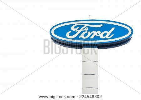 Nakhon Ratchasima, THAILAND - Jan 30, 2018 : Large Ford logo sign on white sky background, Ford Motor Company is an American auto maker founded in 1903. And headquartered in Dearborn, Michigan.