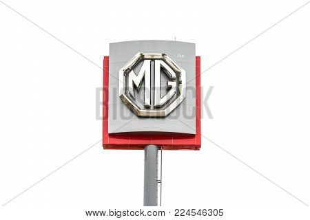 Nakhon Ratchasima, THAILAND - Jan 30, 2018 : MG logo sign on white sky background. MG is an English automotive marque registered by the now defunct MG Car Company Limited, British car manufacturer