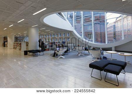 HELSINKI, FINLAND - DECEMBER 9, 2017: People in the Helsinki University Library. It is the largest multidisciplinary university library in Finland