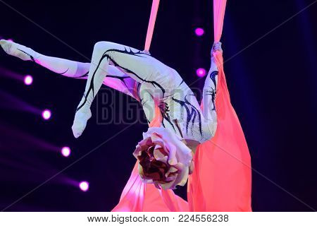 ST. PETERSBURG, RUSSIA - DECEMBER 28, 2017: Aerialist in the premiere of circus show Snow Queen by Great Moscow circus. The show created by Zapashny brothers circus