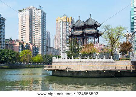 Chengdu, Sichuan Province, China - March 27, 2016 : HeJiang pavilion and JinJiang river in Chengdu on a sunny day.