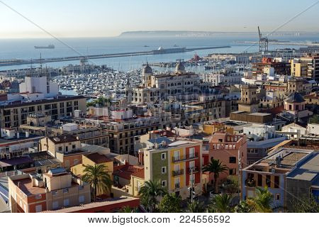ALICANTE, SPAIN - JANUARY 8, 2013: Yachts in the port of Alicante. It's one of the most important ports in Spain for cruises, bringing some 80,000 cruise passengers and 30,000 crew to the city yearly