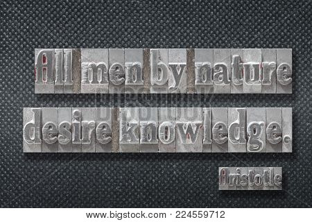 All men by nature desire knowledge - ancient Greek philosopher Aristotle quote made from metallic letterpress on dark background