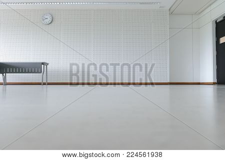 Empty room modern interior - floor with soundproof wall, door, clock and table