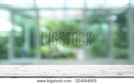 Wood Table Top On Blur Kitchen Window