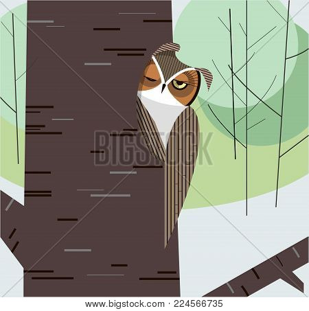 Owl dozes in the hollow of a tree trunk on a background of the forest thicket