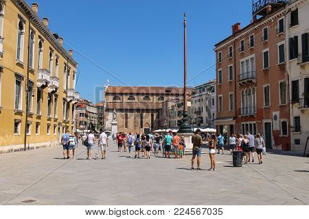 Venice, Italy - August 13, 2016: Tourists walking on St. Stephen's square (campo Santo Stefano)