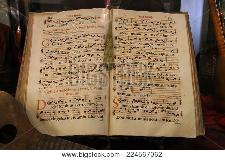 Venice, Italy - August 13, 2016: Antiquarian book with notes behind the glass
