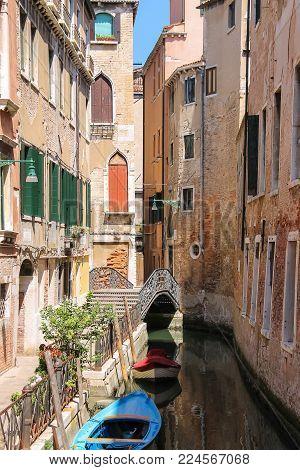 Empty gondola on canal of Venice, Italy