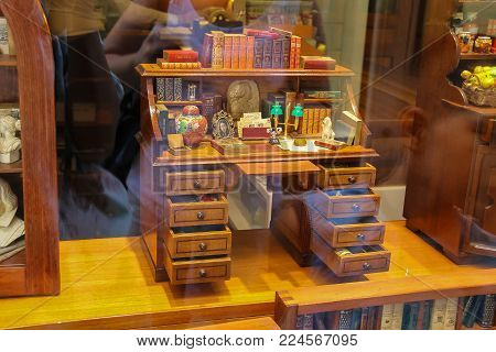 Venice, Italy - August 13, 2016: Decorative wooden desk in vintage style in window of souvenir store (San Marco)