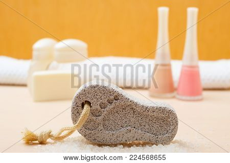 Feet nails care. Pedicure accessories set tools, soap, varnish and stone pumice with foot print