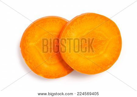 Close Up Top View Of Fresh Two Carrot Slice Isolated On White Background, File Contains A Clipping P