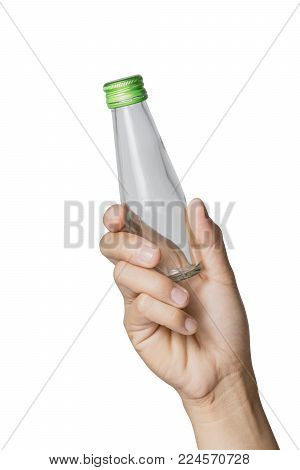 Woman's hand holding empty glass bottle transparent on white background, File contains a clipping path.