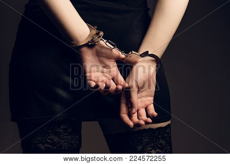 Handcuffed / Woman's hands cuffed behind her back