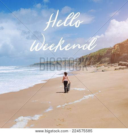 Travel quote, words Hello Weekend. Summer vacation happiness carefree joyful woman standing on sand enjoying tropical beach. Lonely traveler on the ocean coast