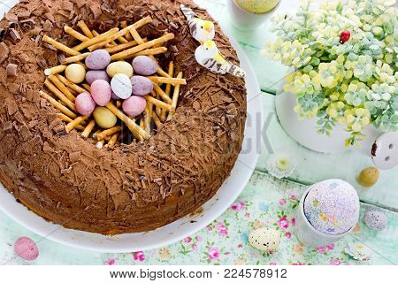 Easter nest cake, delicious chocolate cake with candy eggs for Easter holiday