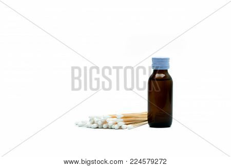 Cotton sticks and antiseptic solutions in amber glass bottle isolated on white background. Concept of Umbilical cord care for helps prevent infection. Infant's umbilical cord cleaning care equipment.