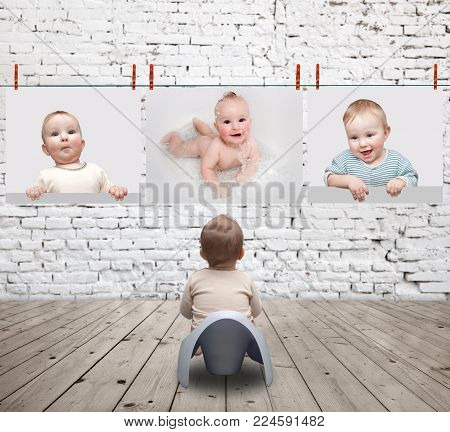 small child on the potty looking at photos