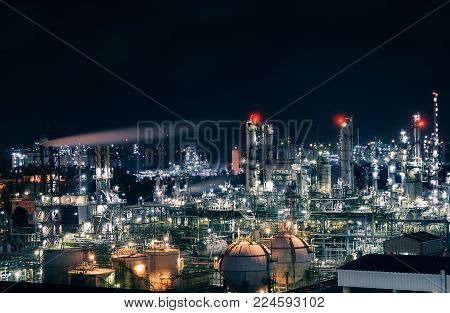 Industrial estate of petrochemical at night, Glowing light of petrochemical industry