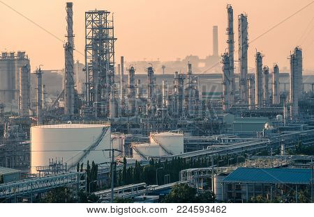Factory of petrochemical industry plant at evening, Hydrocarbons industrial with distillation tower, Manufacturing of oil and gas with fossil petroleum