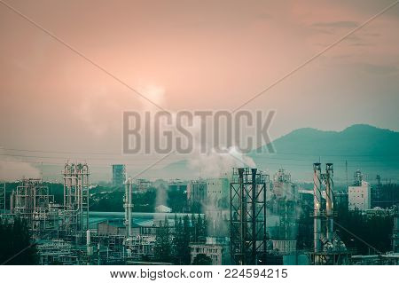 Pollution from chemical industrial estates with smoke stacks and pastel tone