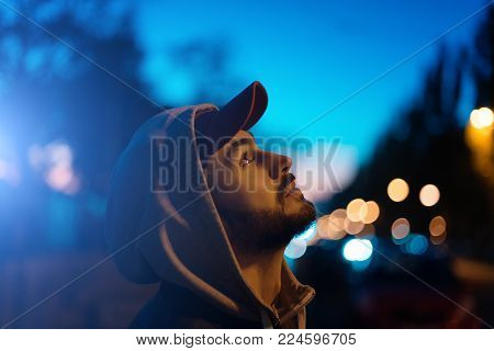 The Guy Makes A Photo Of The Sunset On The Phone. Tourist With Phone.photos And Low Keys And With A