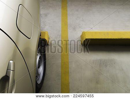 empty parking car with yellow line deviding car