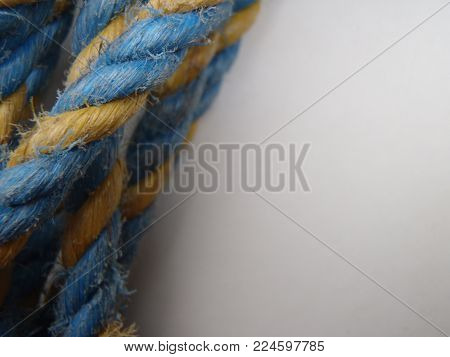 Blue and yellow rope on a white background