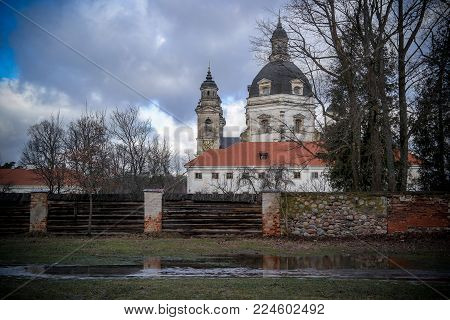 Pazaislis monastery and church Lithuanian: Pazaislio vienuolynas ir baznycia is a large monastery complex in Kaunas, Lithuania, and the example of Italian Baroque architecture.