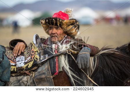 OLGIY, MONGOLIA - SEP 30, 2017: Eagle Hunter at traditional clothing during annual national competition with birds of prey
