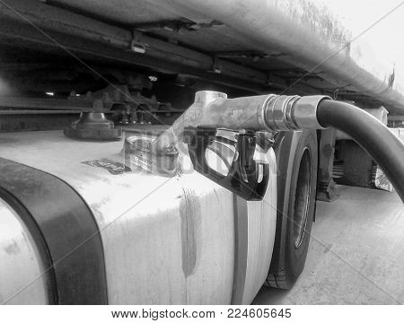 Deposit Of Truck With Pump Dispenser Of Gasoline Image In White And Black