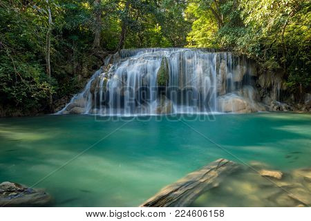 Erawan Waterfall with fish in water in Kanchanaburi Province, Thailand