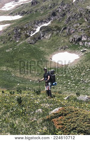 Traveler With A Backpack In The Mountains.